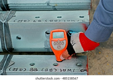 SARABURI-THAILAND-APRIL 8 : Magnetic thickness gauge of hot-dip galvanized steel member for steel tower in Transmission line at warehouse on April 8, 2015 Saraburi Province, Thailand