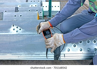SARABURI-THAILAND-JULY 13 : Magnetic thickness gauge for coating Hot-dip galvanized steel member for steel tower in Transmission line on July 13, 2017 Saraburi Province, Thailand.