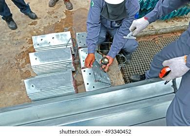 SARABURI-THAILAND-JUNE 30 : Dimension check Hot-dip galvanized steel structure by Measuring Tape on June 30, 2016 Saraburi Province, Thailand.