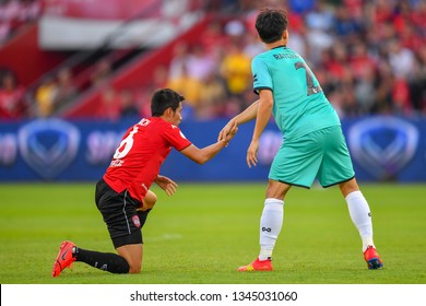 Sarach Yooyen no.6 (L) of SCG Muangthong United in action during The Football Thai League between SCG Muangthong United and PT Prachuap F.C.at SCG Stadium on February24,2019 in Nonthaburi, Thailand