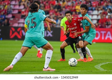Sarach Yooyen (red)of SCG Muangthong United in action during The Football Thai League match between SCG Muangthong United and PT Prachuap F.C.at SCG Stadium on February24,2019 in Nonthaburi,Thailand