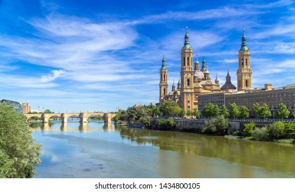 Saragossa / Spain - May 6th, 2019: Cathedral-Basilica of Our Lady of the Pillar on the banks of the River Ebro