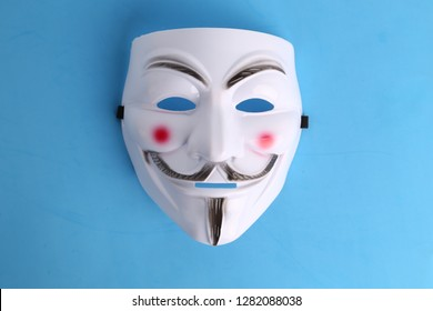 Saragossa Spain. September 18, 2018, Mask of the vendetta on background. This mask is a well-known symbol for the online hacktivist group Anonymous