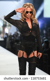 Sarah Harding on the Agent Provocateur catwalk at the Lingerie London show at Old Bilinsgate Market, London 24/10/2012 Picture by: Steve Vas