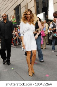 Sarah Jessica Parker, in a Halston Heritage dress, Christian Loboutin shoes and Chanel bag, on location for SEX AND THE CITY 2 Movie Shoot-TUE, Bergdorf Goodman, New York September 8, 2009