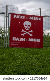 Sarajevo, 08/07/2018: barbed wire and warning sign for landmines in the reproduction of a minefield at the Sarajevo Tunnel Museum which housing the underground tunnel built in 1993 during the Siege