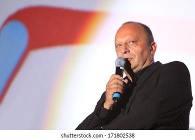SARAJEVO - AUGUST 17: The Sarajevo Film Festival director Mirsad Purivatra holds a speech at the open air cinema during the 19th Sarajevo Film Festival on August 17, 2013 in Sarajevo.
