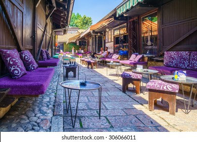 SARAJEVO, BIH - JULY 05, 2015: Typical street and cafe scene, with local businesses, locals and tourists, in Sarajevo, Bosnia and Herzegovina
