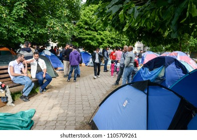 Sarajevo, BiH, May 15, 2018 - Refugee And Migrants Camp In Sarajevo Bosnia And Herzegovina. The European migrant crisis. Balkan Route. Tents in park. Migrants from Syria, Pakistan, Afghanistan, Iraq