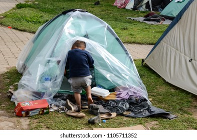 Sarajevo, BiH, May 15, 2018 - Child in Refugee And Migrants Camp In Sarajevo Bosnia And Herzegovina. The European migrant crisis. Balkan Route. Tents in park.