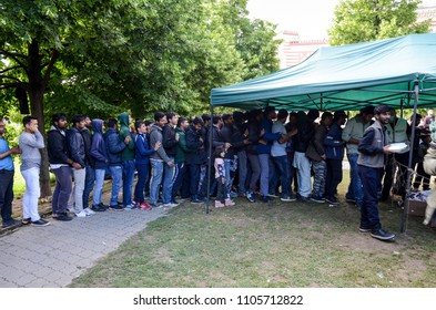 Sarajevo, BiH, May 15, 2018 - Food line in Refugee And Migrants Camp In Sarajevo Bosnia And Herzegovina. The European migrant crisis. Balkan Route. Tents in park.