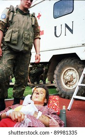 SARAJEVO, BOSNIA - APR 4: A Ukrainian soldier, in Bosnia with United Nations Protection Force (UNPROFOR),  watches over a Bosnian woman wounded in Gorazde in a medical facility in Sarajevo, Bosnia, on Monday,  April 4, 1994.