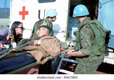 SARAJEVO, BOSNIA - APRIL 19: Red Cross workers and Ukrainian soldiers with the United Nations help a wounded Bosnian man  after he was evacuated from the town of Gorazde by UN troops  Apr 19, 1994 in Sarajevo, Bosnia.