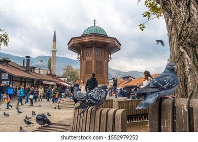 Sarajevo, Bosnia and Herzegovina - 11.01.2019: Bascarsija square with Sebilj wooden fountain in Old Town Sarajevo, the capital city of Bosnia and Herzegovina