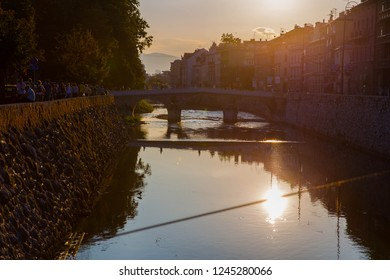 Sarajevo, Bosnia and Herzegovina - 11.11.2018: Sunset view of Miljacka river flowing under the Latin Bridge