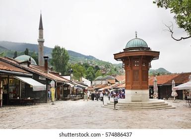 SARAJEVO. BOSNIA AND HERZEGOVINA. 13 MAY 2012 : Sebilj fountain on Bascarsija square in Sarajevo. Bosnia and Herzegovina