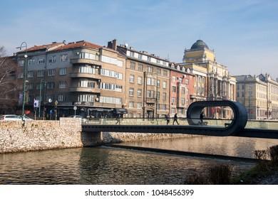 Sarajevo, Bosnia and Herzegovina - 27 January 2018 - View of Sarajevo and Festina Lente bridge over river Miljacka, on a sunny day.