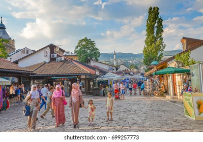 Sarajevo, Bosnia and Herzegovina- 7 July, 2014: unidentified people walk at Pedestrian Market area of Bascarsija square dzamija Mosque, here is old market-place, historical cultural centre of Sarajevo