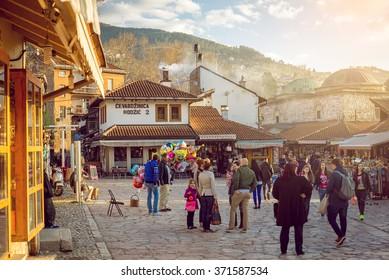 SARAJEVO, BOSNIA AND HERZEGOVINA - APRIL 19: Tourists and locals walk in old city Bascarsija area on April 19, 2015 in Sarajevo.
