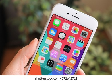 SARAJEVO , BOSNIA AND HERZEGOVINA - April 22, 2015: New gray iPhone 6 with colorful screen in woman's hand. iPhone 6 was created and developed by the Apple inc.
