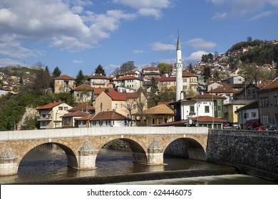 SARAJEVO, BOSNIA AND HERZEGOVINA - APRIL 9, 2017: Beautiful bridge Seher-cehajina cuprija and Inat Kuca (House of Spite) on Miljacka river, one of the symbols of Sarajevo.