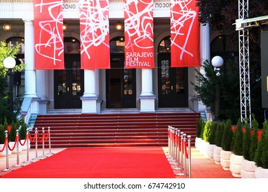 SARAJEVO - BOSNIA AND HERZEGOVINA - AUGUST 14 , 2016 : Red carpet and the main entrance of the 22nd Sarajevo Film Festival in front of National theater in Sarajevo , Bosnia and Herzegovina