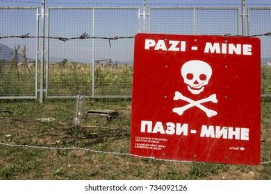 SARAJEVO, BOSNIA AND HERZEGOVINA - AUGUST 19 2017: Caution mines sign in a minefield in Sarajevo