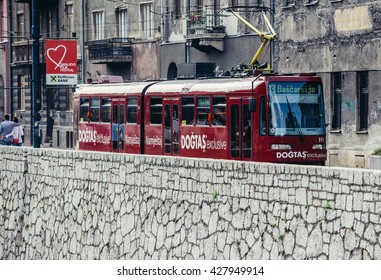 Sarajevo, Bosnia and Herzegovina - August 23, 2015: red tram car at Obala Kulina Bana Street in Sarajevo city