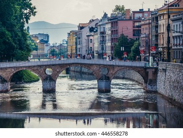 Sarajevo, Bosnia and Herzegovina - August 23, 2015. People walks on Latin Bridge over Miljacka river in Sarajevo
