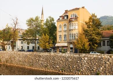 SARAJEVO, BOSNIA AND HERZEGOVINA - AUGUST 25, 2012: The houses on embankment of the Miljacka river in Sarajevo city. Sarajevo is the capital of Bosnia and Herzegovina.