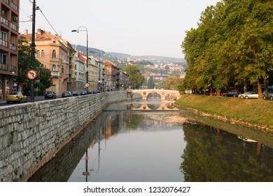 SARAJEVO, BOSNIA AND HERZEGOVINA - AUGUST 25, 2012: Sarajevo cityscape with the Miljacka river and the Latin bridge. Sarajevo is the capital of Bosnia and Herzegovina.