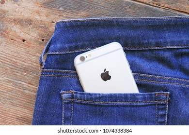 SARAJEVO , BOSNIA AND HERZEGOVINA - AUGUST 26 , 2017: Silver iPhone 6 in jeans pocket. iPhone 6 was created and developed by the Apple inc.