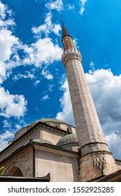 "SARAJEVO, BOSNIA AND HERZEGOVINA - AUGUST 3, 2019: A Large Tower Of A Muslim Mosque Called the ""BEGOVA DŽAMIJA"" (BEG MOSQUE) in Sarajevo"
