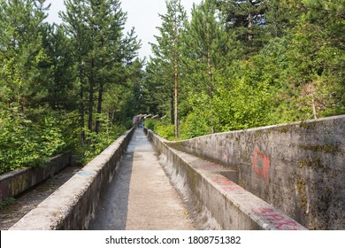 SARAJEVO, BOSNIA AND HERZEGOVINA - CIRCA JULY 2018: Abandoned Olympic Bobsleigh / Bobsled and Luge Track, built for the Olympic Winter Games in 1984.