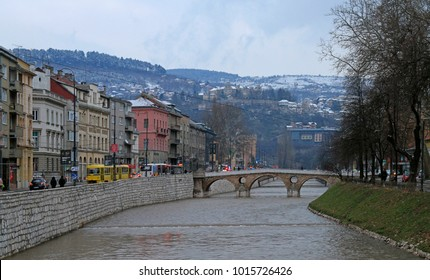 Sarajevo, Bosnia and Herzegovina - December 19, 2017: Latin Bridge is a historic Ottoman bridge over the River Miljacka in Sarajevo, Bosnia and Herzegovina