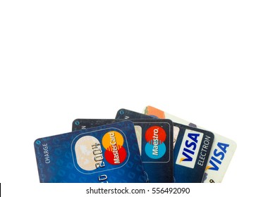 Sarajevo, Bosnia and Herzegovina - January 15, 2017: closeup pile of credit cards, Visa, Maestro and MasterCard logos, credit, debit and electronic. Isolated on white background