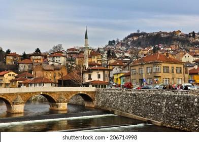 SARAJEVO, BOSNIA AND HERZEGOVINA - JANUARY 8: Latin bridge on Miljacka river on January 8, 2013 in Sarajevo, Bosnia. This is where Archduke Franz Ferdinand of Austria was assassinated in 1914.