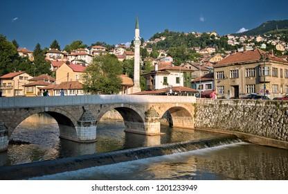 SARAJEVO, BOSNIA AND HERZEGOVINA - JULY 14, 2018: Sarajevo Old Town and bridge on Miljacka River