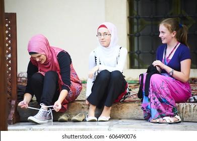 Sarajevo, Bosnia and Herzegovina - July 30, 2012: Muslim women in the main Sarajevo Mosque of Gazi Husrev-beg. Part of the mosque reserved for women
