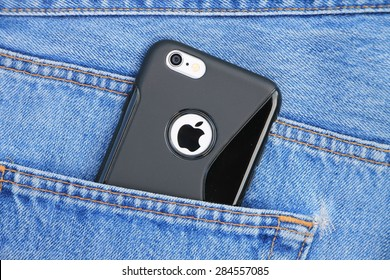 SARAJEVO , BOSNIA AND HERZEGOVINA - JUNE 03 , 2015: Silver iPhone 6 with black case in jeans pocket. iPhone 6 was created and developed by the Apple inc.