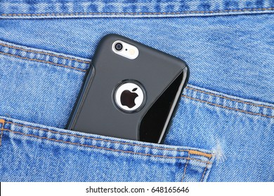SARAJEVO , BOSNIA AND HERZEGOVINA - JUNE 05 , 2015: Silver iPhone 6 with black case in jeans pocket. iPhone 6 was created and developed by the Apple inc.