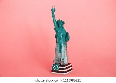 SARAJEVO - BOSNIA AND HERZEGOVINA - JUNE 16 , 2018 : The Statue of liberty figure on pink background.