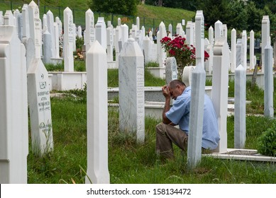 SARAJEVO, BOSNIA AND HERZEGOVINA - JUNE 18: An unidentified man visits a grave on June 18, 2009 in Sarajevo, Bosnia and Herzegovina. More than 2.500 war victims (1992-1993) are buried in this cemetery