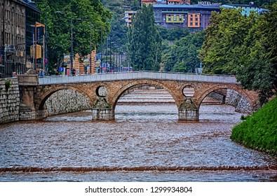 SARAJEVO, BOSNIA AND HERZEGOVINA, June 20 2018: Latin Bridge at river Miljacka in Sarajevo, Bosnia and Herzegovina.