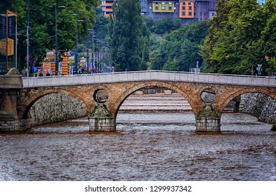 SARAJEVO, BOSNIA AND HERZEGOVINA, June 20 2018: Old Latin Bridge at Miljacka river in Sarajevo, Bosnia and Herzegovina,