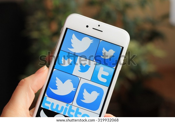 SARAJEVO , BOSNIA AND HERZEGOVINA - JUNE 29 , 2015: Woman with Twitter icons on Apple iPhone 6. Twitter is one of the largest and most popular social networking sites in the world.
