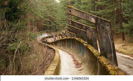 Sarajevo / Bosnia and Herzegovina - March 2016: Former Olympic Bobsleigh / Bobsled and Luge Track in the forest.