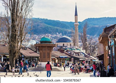 SARAJEVO, BOSNIA AND HERZEGOVINA - March 2018: People walking near Sebilj fountain in Pigeon Square, Bascarsija quarter, Sarajevo
