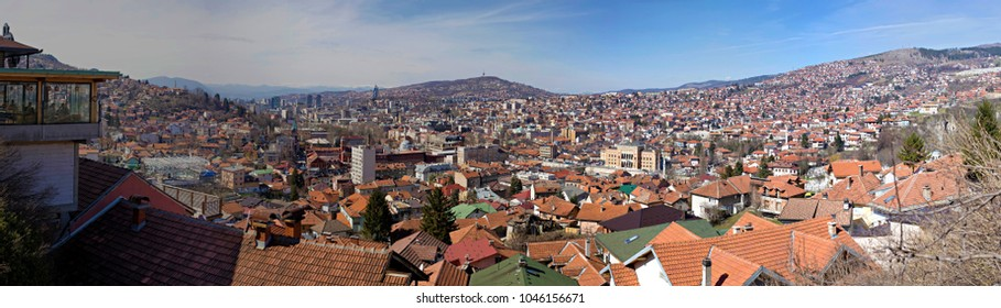 SARAJEVO, BOSNIA AND HERZEGOVINA - March 2018:  Aerial panoramic view of Sarajevo old town roofs and houses on the hills, Sarajevo, Bosnia and Herzegovina