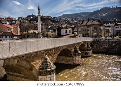 SARAJEVO, BOSNIA AND HERZEGOVINA - March 2018: View of Sarajevo old town from the riverside with bridge and mosque, Sarajevo, Bosnia and Herzegovina
